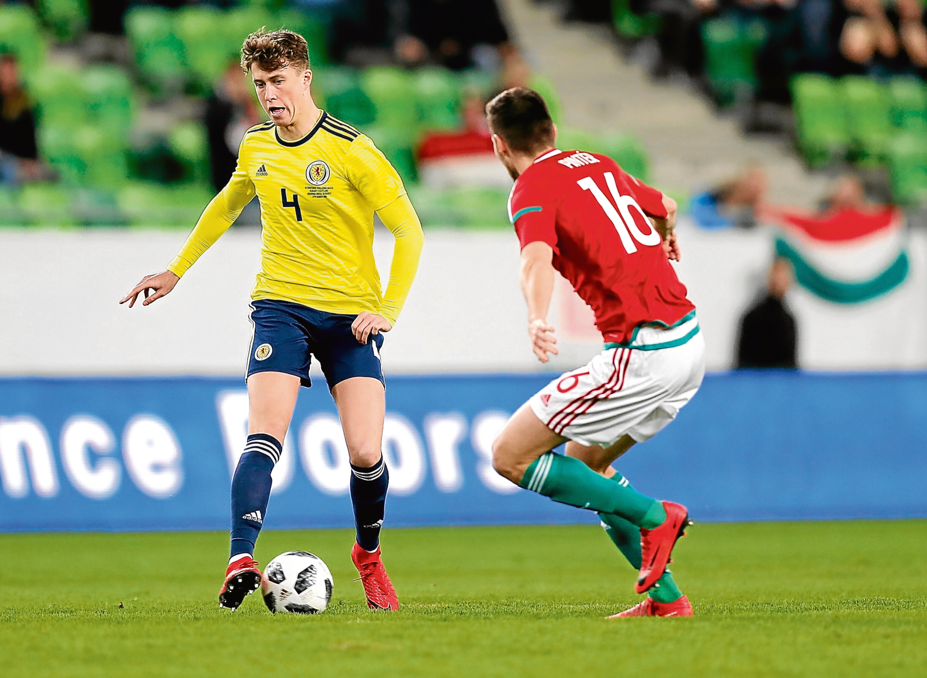 BUDAPEST, HUNGARY - MARCH 27: Adam Pinter of Hungary (r) and Jack Hendry of Scotland (l) in action during the International Friendly match between Hungary and Scotland at Groupama Arena on March 27, 2018 in Budapest, Hungary. (Photo by Laszlo Szirtesi/Getty Images)