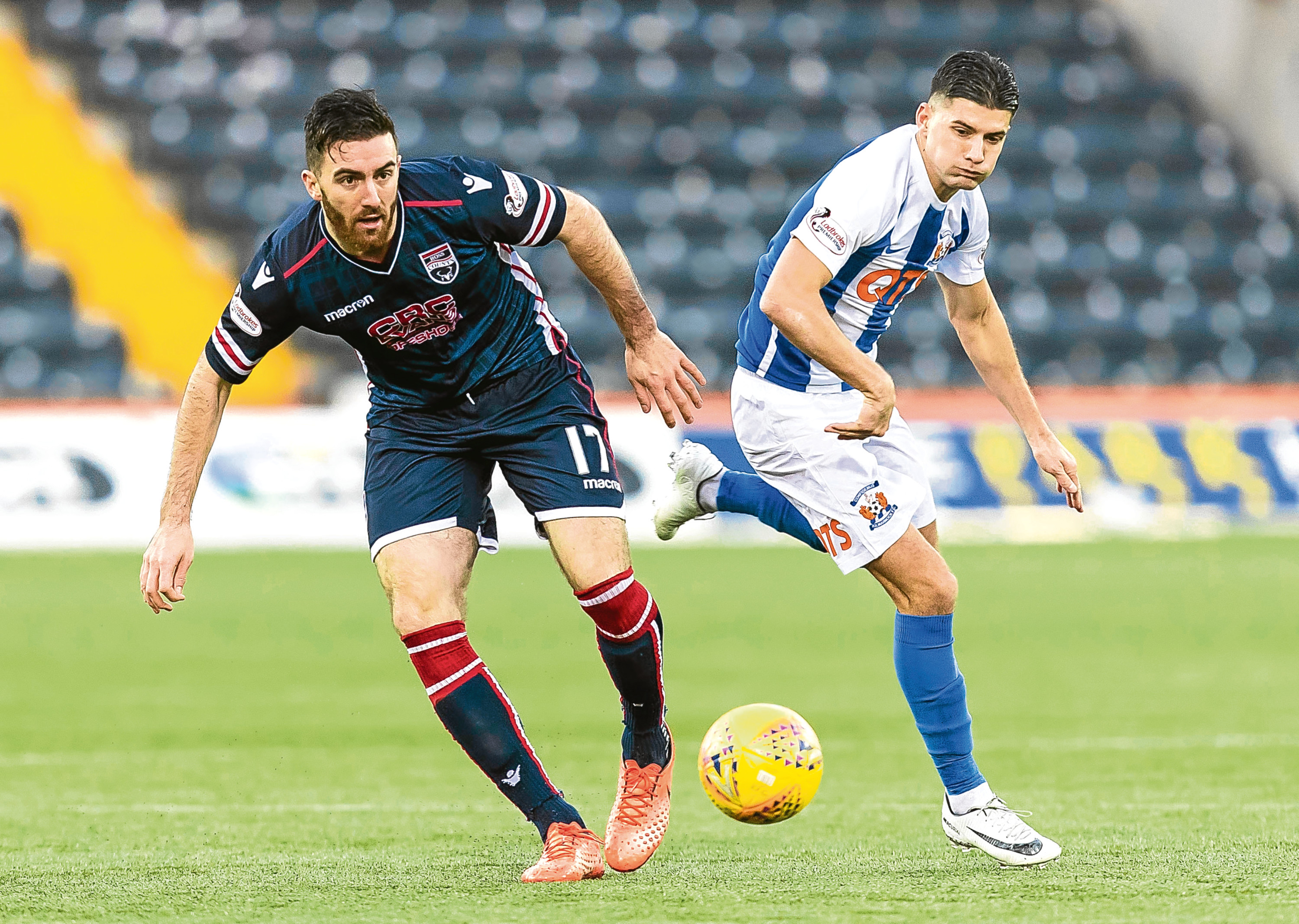 Ross Draper (left) has signed a new one-year deal with Ross County.
