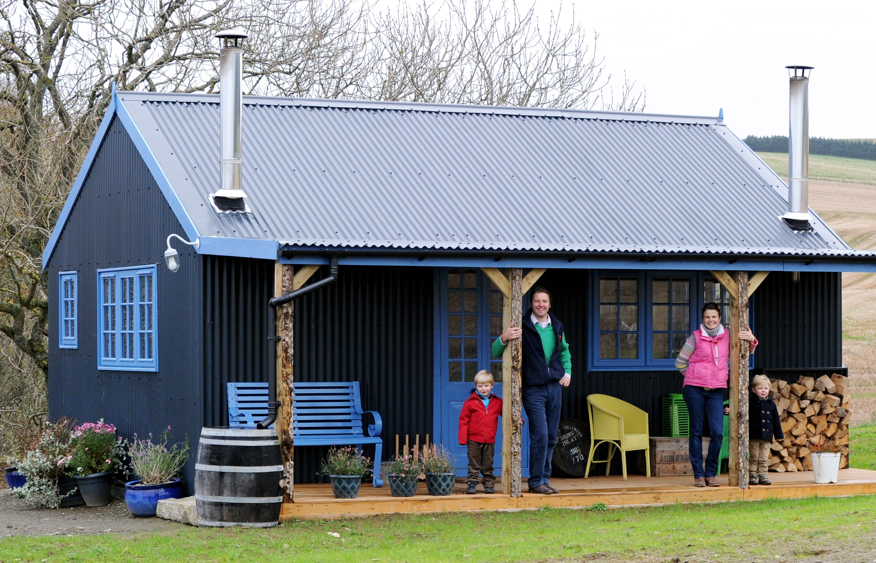 Jane and James Foad with children Hector, 2 and Freddie, 4 at their farm bothy at Newton of Begshill, Drumblade