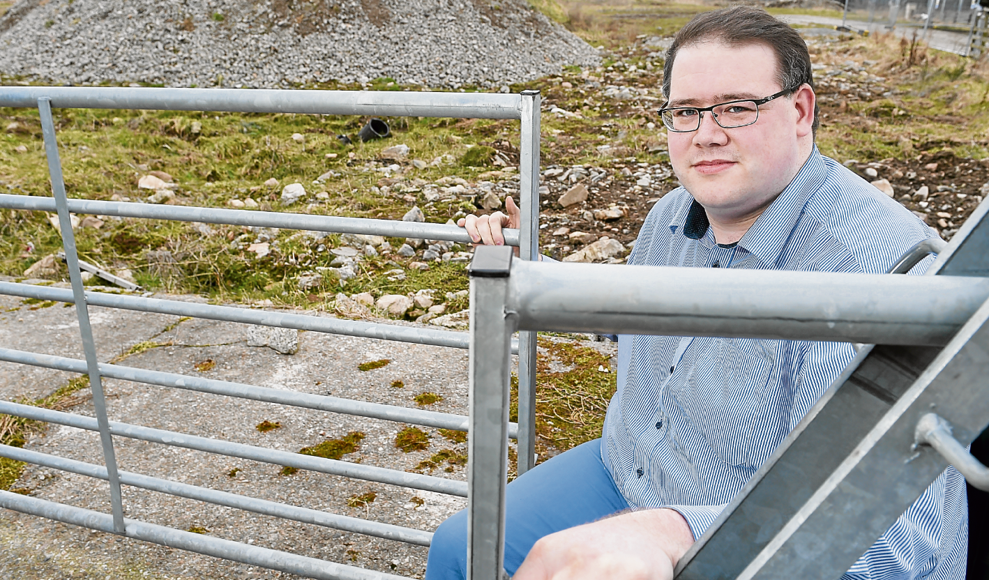 Highland councillor Andrew Jarvie at the site of the proposed housing development at Viewhill Farm