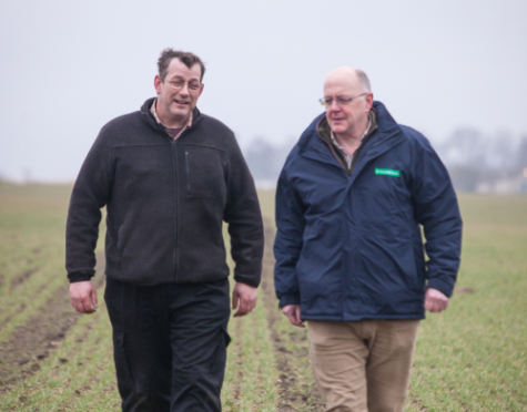 Farm manager Craig Norrie, left, and Douglas Bonn, of Nickerson seed company, with this year's wheat crop