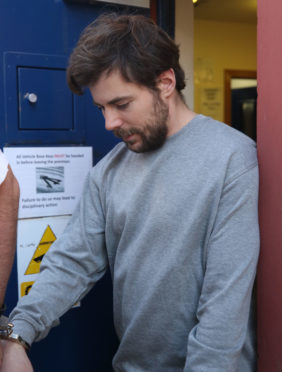 Dawid Grzybek being taken from Inverness Sheriff Court.