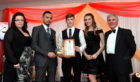Pictured are the team from Nagendras collecting their award.