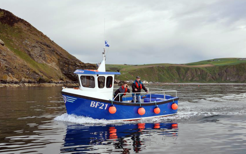 Iain West, deputy harbour master of Gardenstown and his boat – Explorer