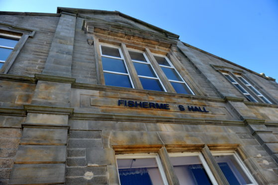 Volunteers behind Buckie's Fisherman's Hall are celebrating a year in charge.