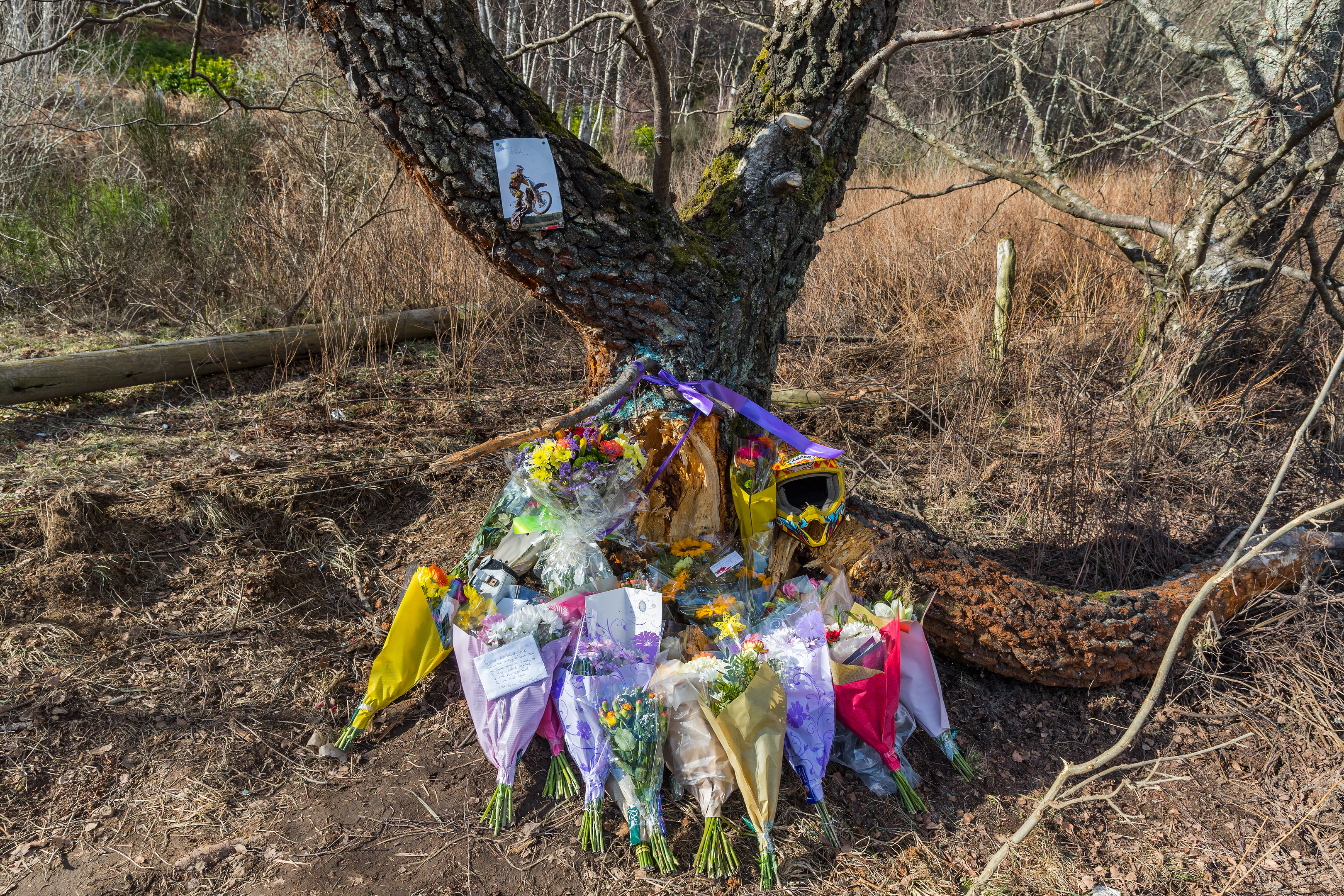 Tributes at the scene of the accident on the B9015 Mosstodloch to Rothes Road at Orton, Moray.