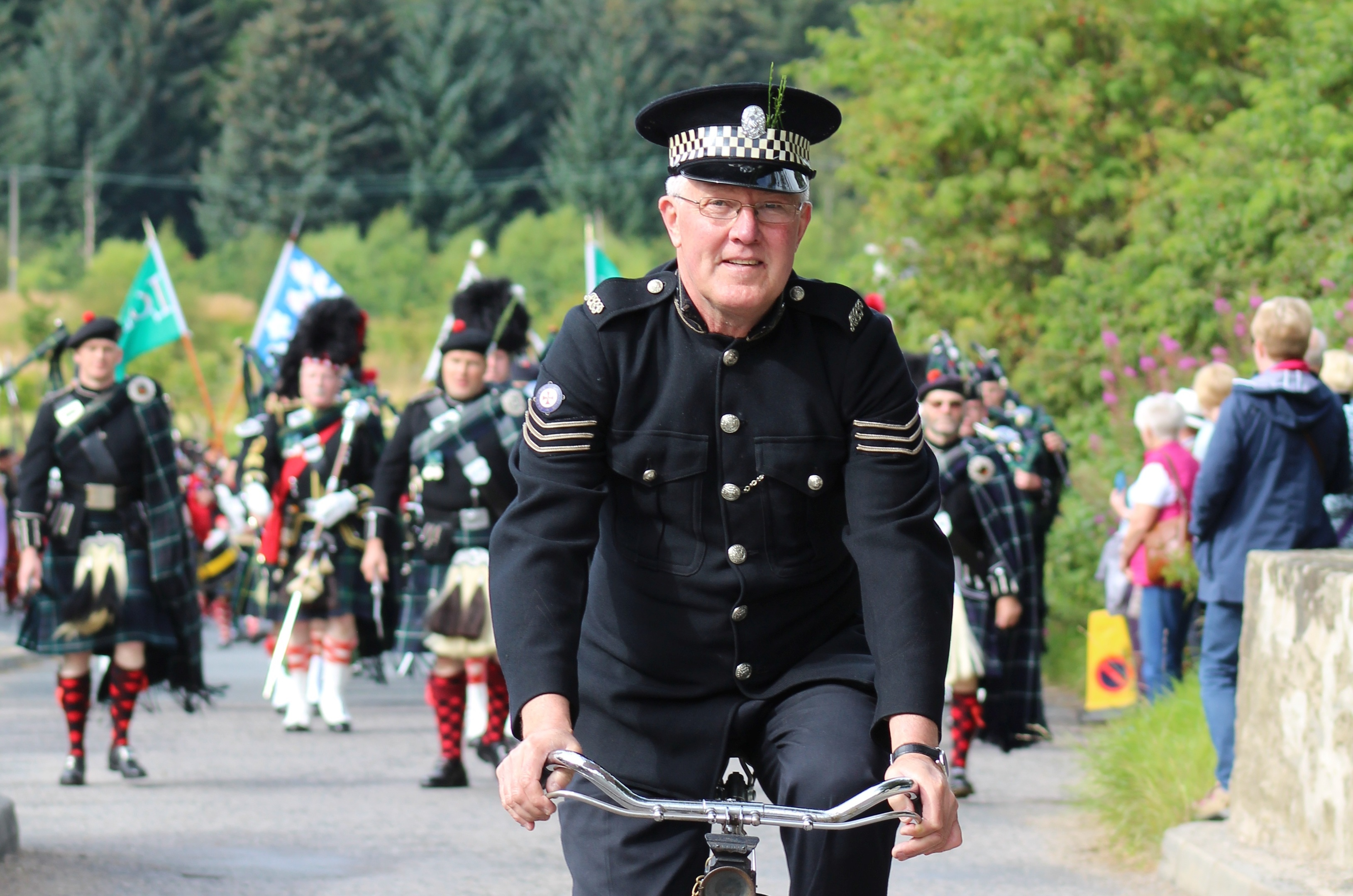 Jim Mitchell, the bobby on the bike, escorted the Lonach March