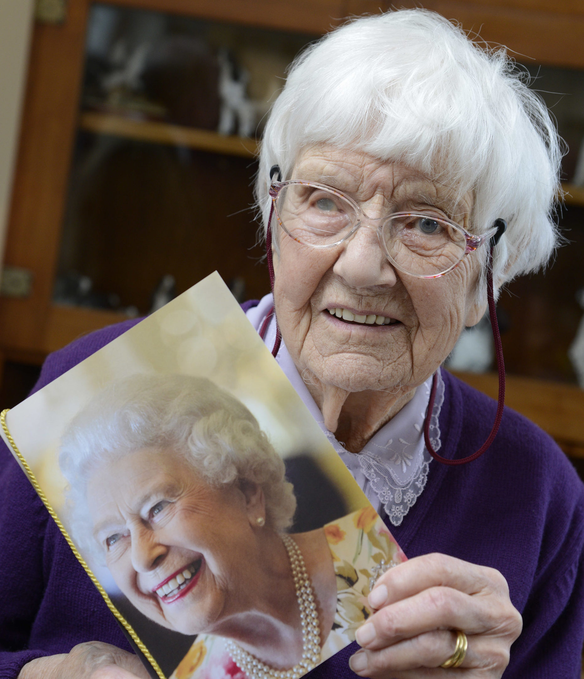 100-year-old Mona Brown from Salen with her card from the Queen.
