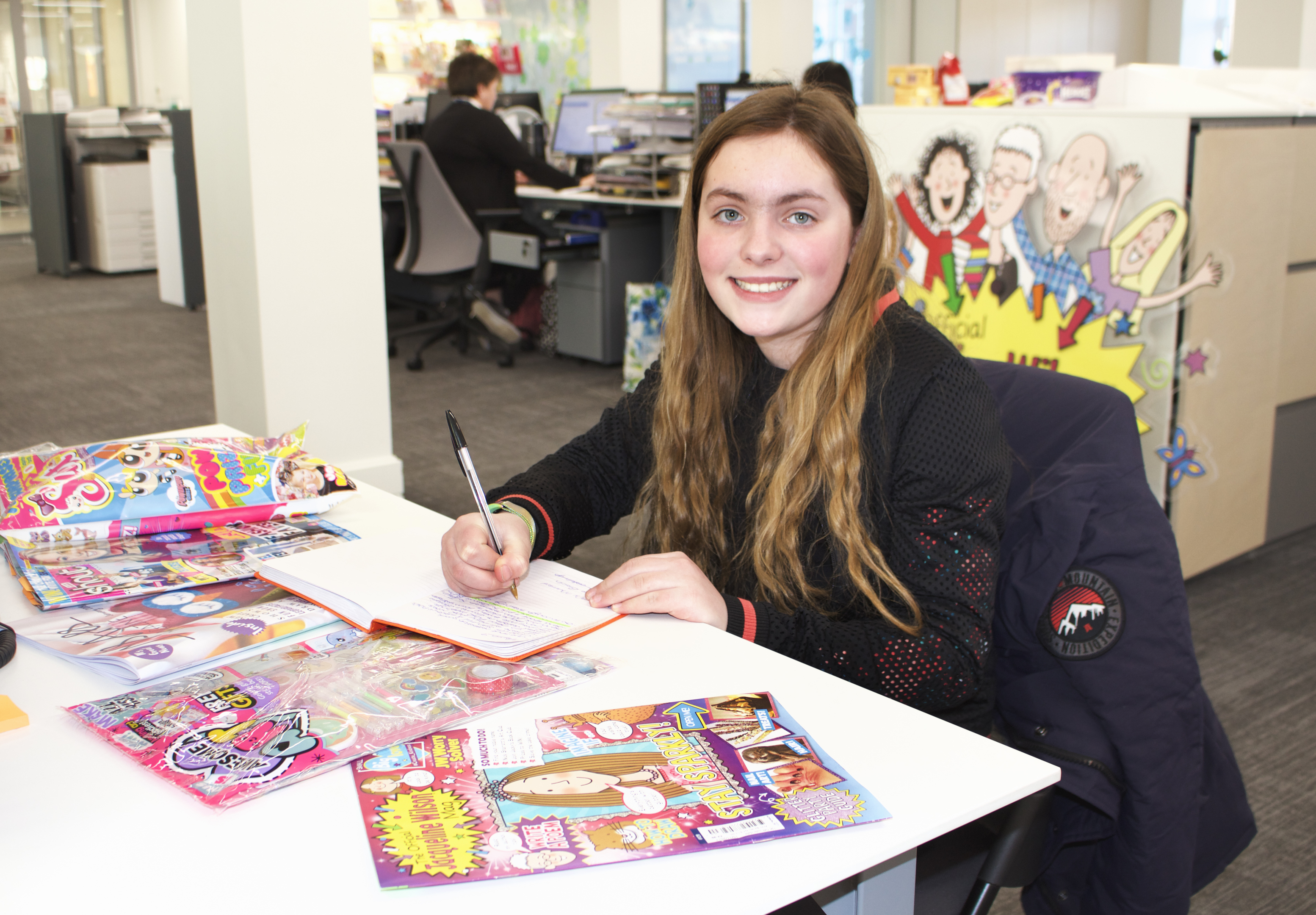 Mirissa Efemey at her very own desk for the day in DC Thomson's children's magazine department, Dundee.