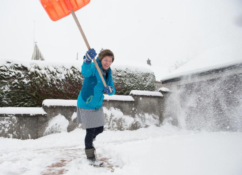 Brenda Cooper clearing her drive in Craigellachie.