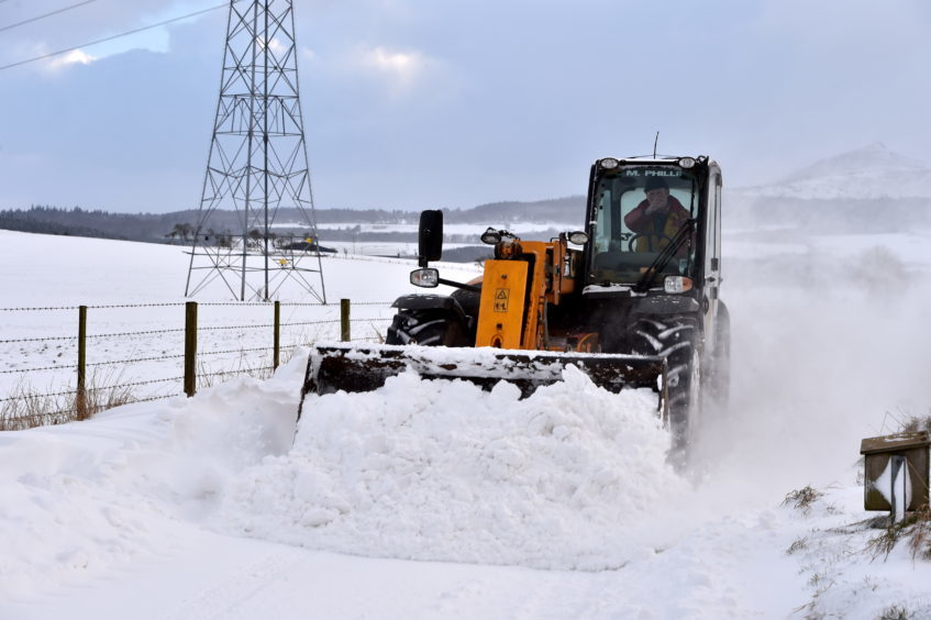 A farmer clears his road at Old Rayne.