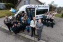 Minibus compition winners - 1st Methlick Scout Group, Methlick. Picture of Methlick Scout Group and (centre L-R) Keith Hewitt (scouts) and Ray Riddoch (Nexen) during the handover.