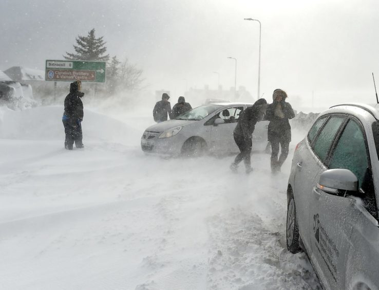 Motorists stuck in deep drifting snow on the A9 on the outskirts of Brora.
