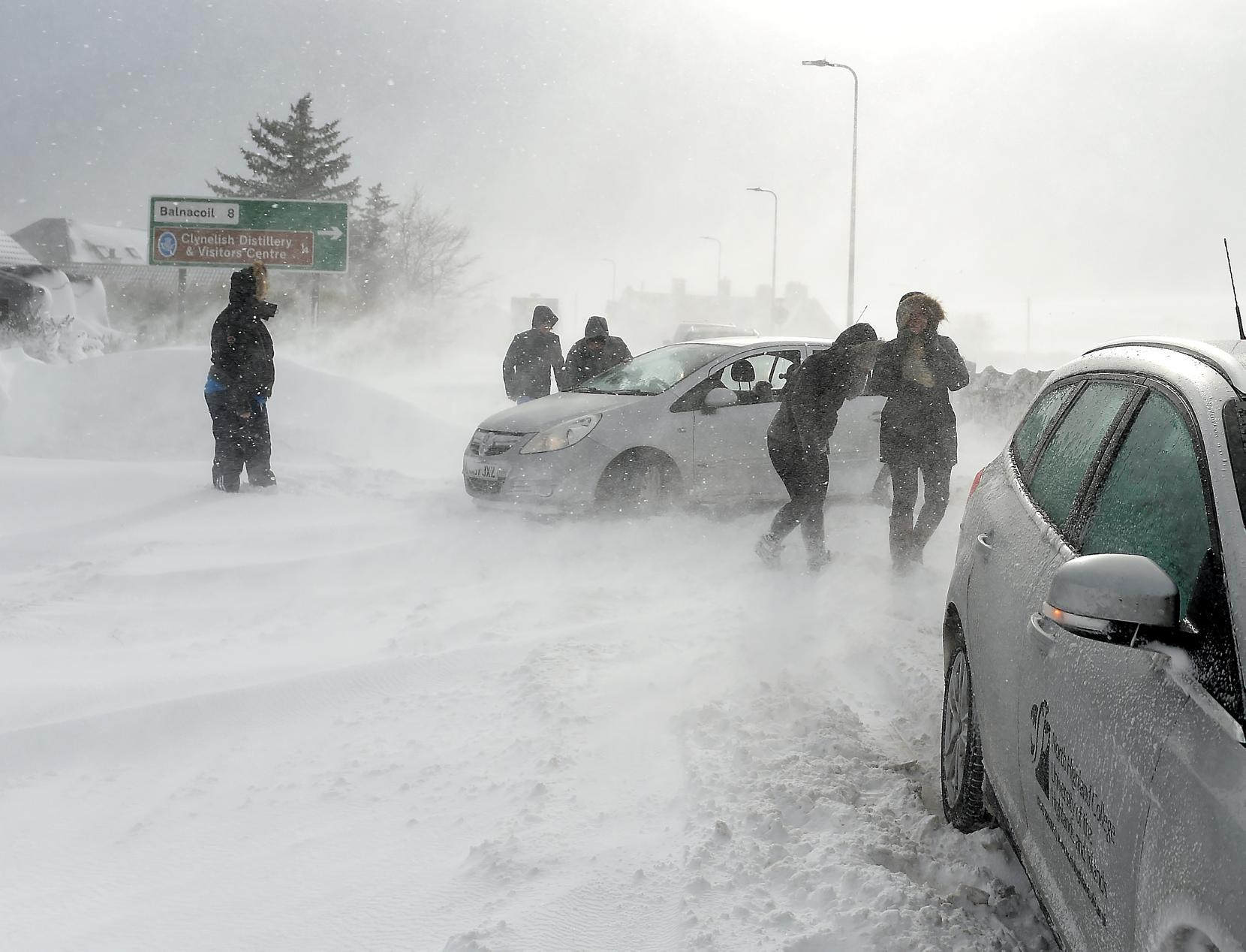 Motorists stuck in deep drifting snow on the A9 on the outskirts of Brora yesterday afternoon.