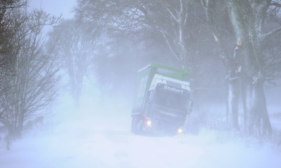 HGV driver has found the ditch on the A9 south of Golspie in heavy drifting snow.