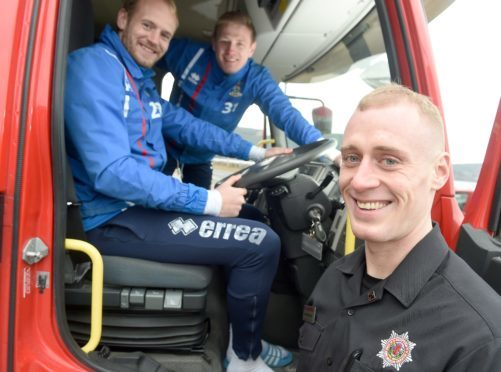 Inverness firefighter Conor Cormack in safe hands yesterday with Caley Thistle goalkeepers Mark Ridgers (left) and Cameron Mackay. Picture by Sandy McCook.