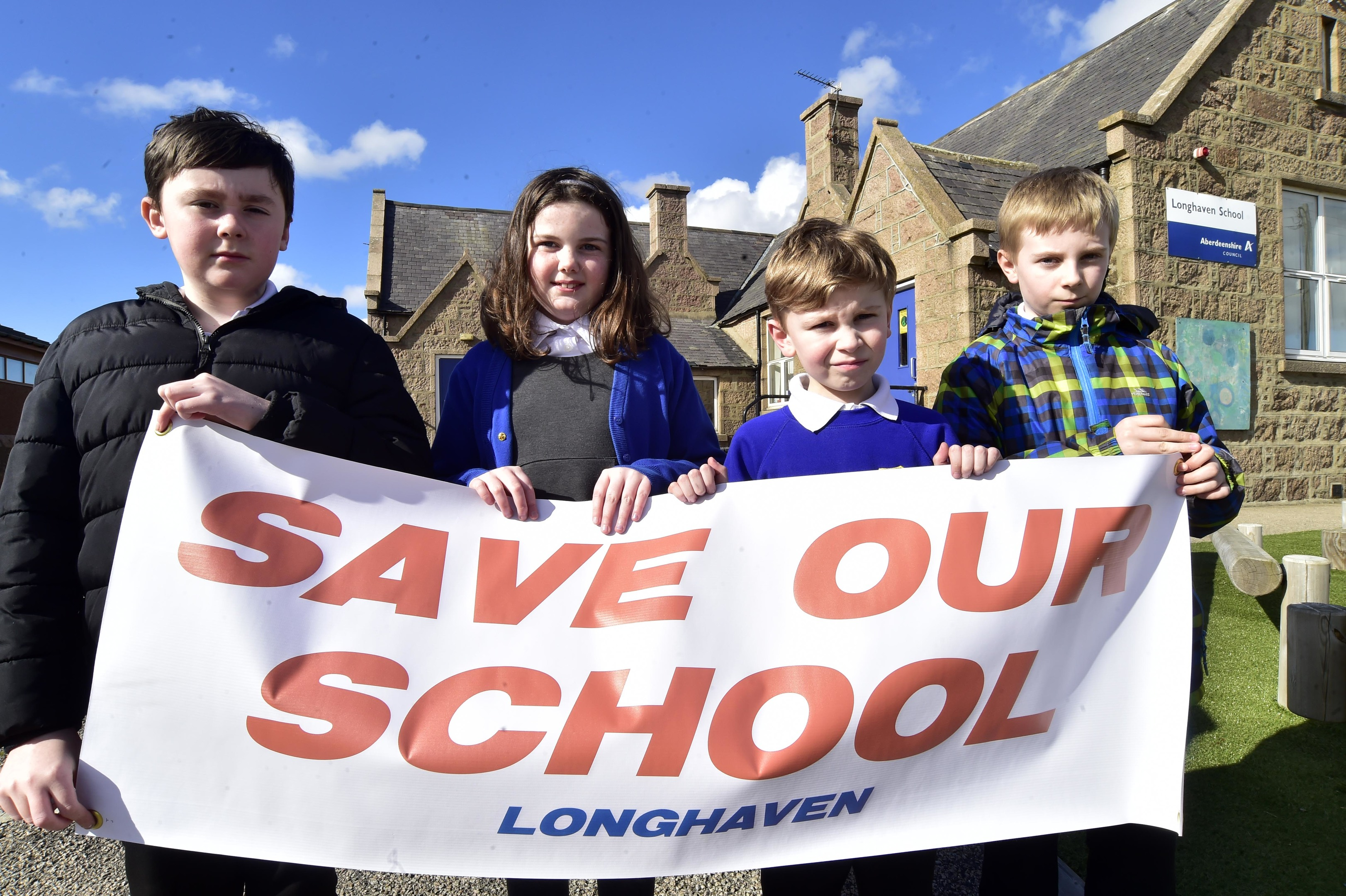 Longhaven Primary pupils campaigning to save their school.