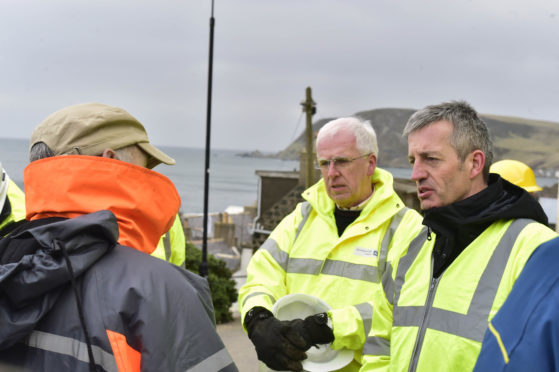 Aberdeenshire council leader Jim Gifford and CEO Jim Savegetalk to local resident Colin Wallek.