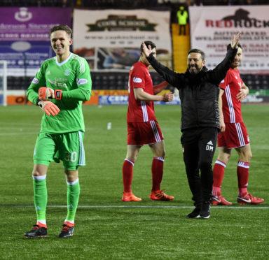 Aberdeen's Freddie Woodman celebrates after the shootout.