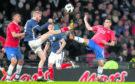 Scotland's Oliver McBurnie (left) and Costa Rica's David Guzman battle for the ball during the international friendly match at Hampden Park, Glasgow.