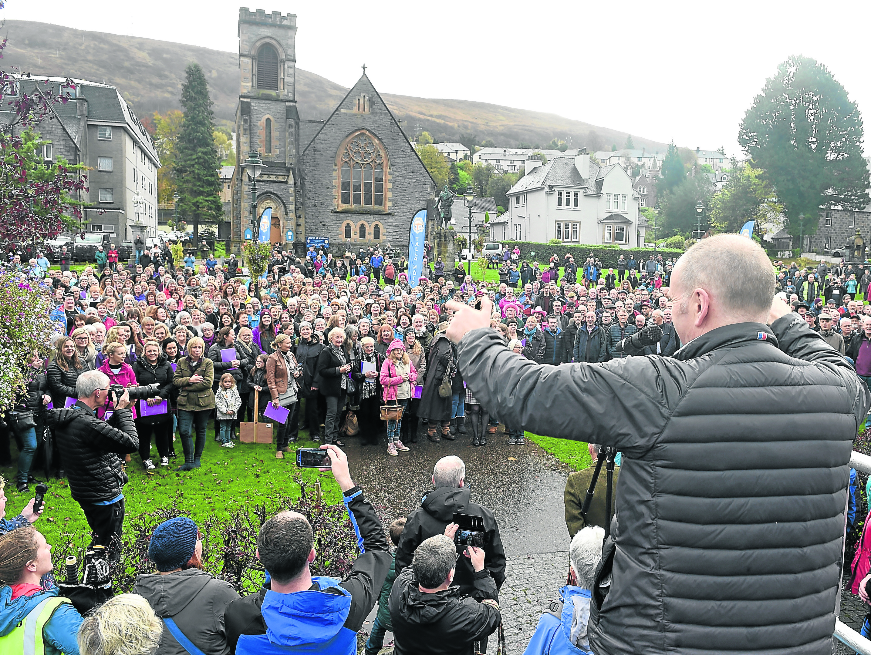 The Massed Choirs are led through Fort William by the Lochaber Pipe Band before performing on The Parade in the centre of the town before making their way home following the Royal National Mod.