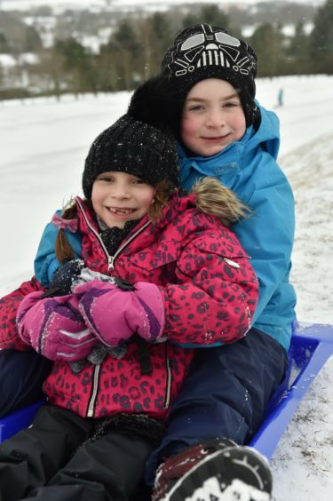 Westhill Golf Course was turned into a winter wonderland as sledges descended on the slopes. Alexander with cousin Francesca.