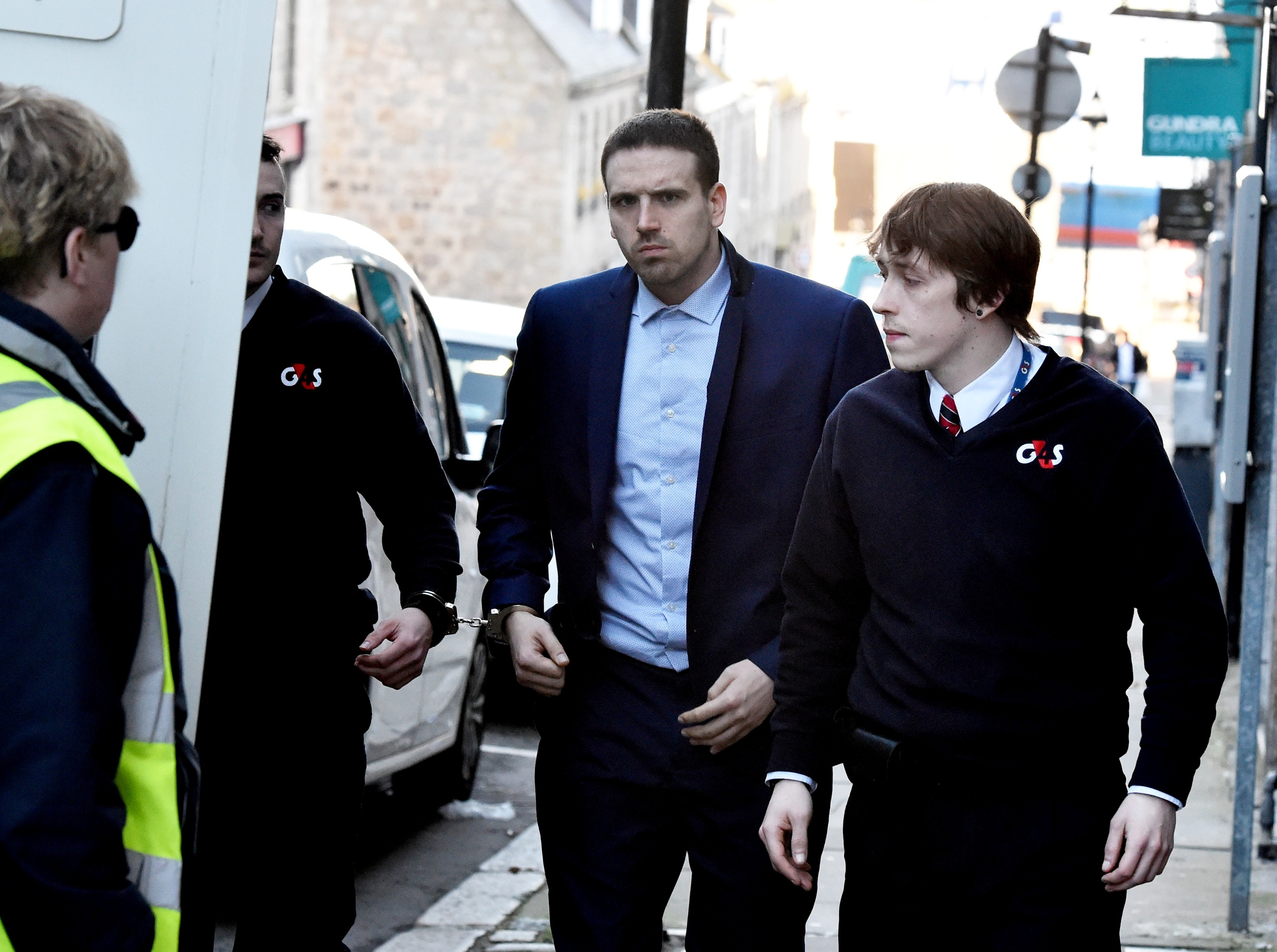 Darren Riley is led from court after his sentence