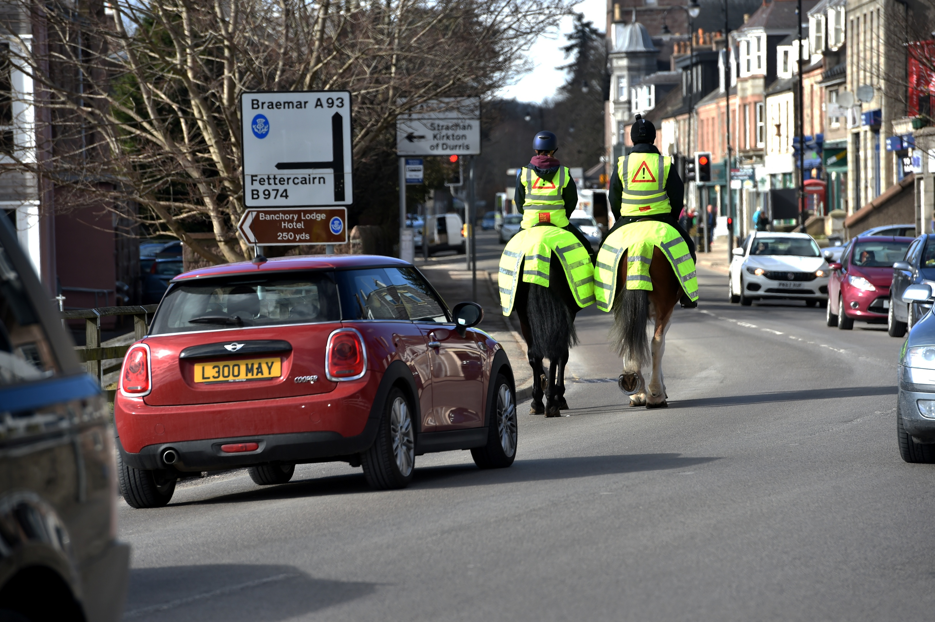 Police Scotland rode through Banchory undercover to see how drivers reacted when passing horses on the road. Many were stopped and warned of their driving if either too close, or driving fast past them. Police officers Simon Wilson and Jennifer Weir on their horses Stewarton and Lewis. Picture by COLIN RENNIE  March 20, 2018.