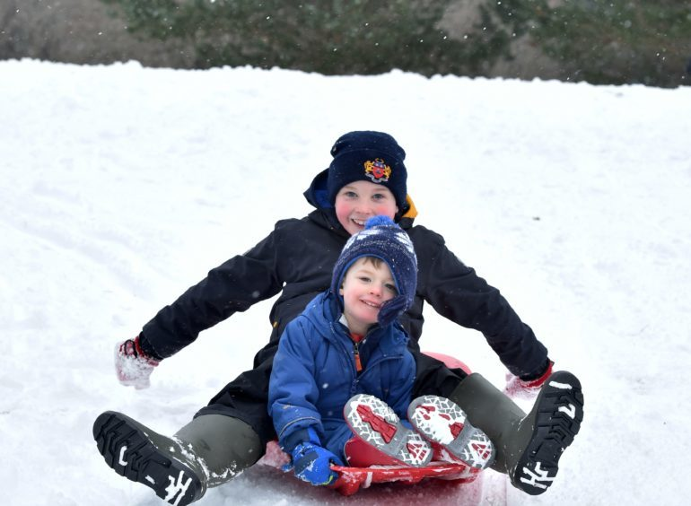 The Beast from the East - Banchory Golf Club was the venue for some fun in the snow for local children whose schools have closed. James, 9 and brother Thomas 2 enjoy the third hole at Banchory.
