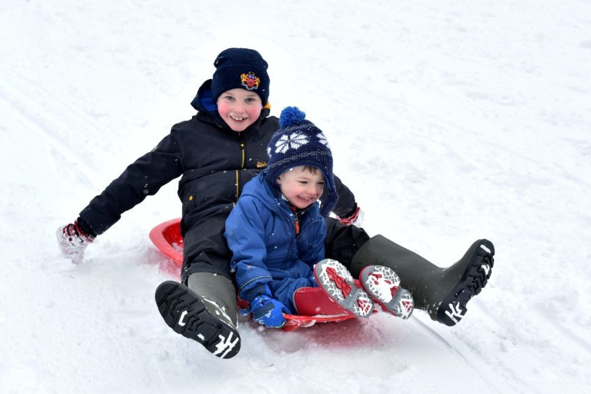 The Beast from the East - Banchory Golf Club was the venue for some fun in the snow for local children whose schools have closed.  James, 9 and brother Thomas 2 enjoy the third hole at Banchory. (no surname please). Picture by COLIN RENNIE February 28, 2018.