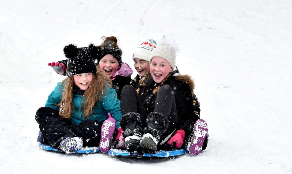 The Beast from the East - Banchory Golf Club was the venue for some fun in the snow for local children whose schools have closed.  Friends Kayleigh Duthie, 10, Emelia Guyan, 10, Ava Cleal, 10 and Olivia Humble, 10 enjoy themselves. Picture by COLIN RENNIE February 28, 2018.