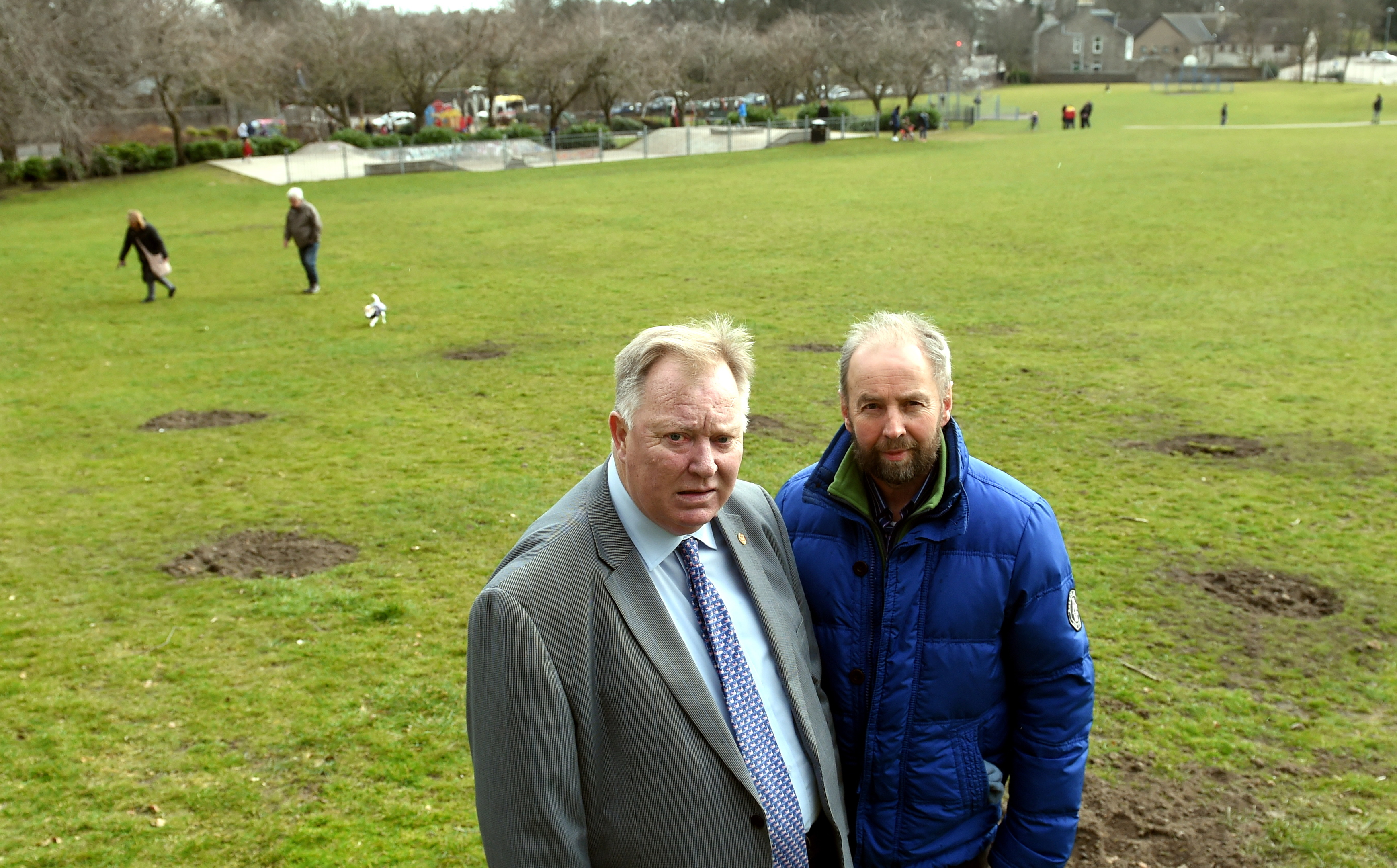 Councillor Bill Cormie, left and Peter Stephen at the site where trees were vandalised at Westburn Park, Aberdeen.