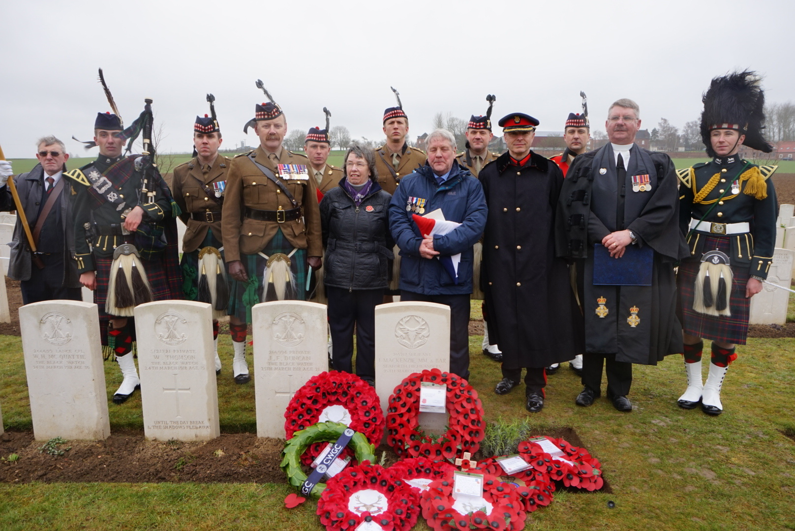 Ken and Kath MacDonald with the Reverend Paul van Sittert and members of the Royal Regiment of Scotland at the service.