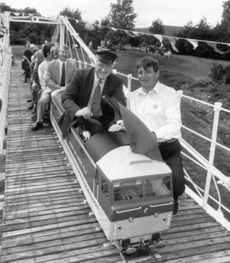 In the driver's seat yesterday at the Ness miniature railway at Whin Park, Inverness, is the late Sir Russell Johnston, MP for Inverness, Nairn and Lochaber between 1983 and 1997, as he is flagged off by Ian Young at the official opening of the Ness railway bridge in August 1989.