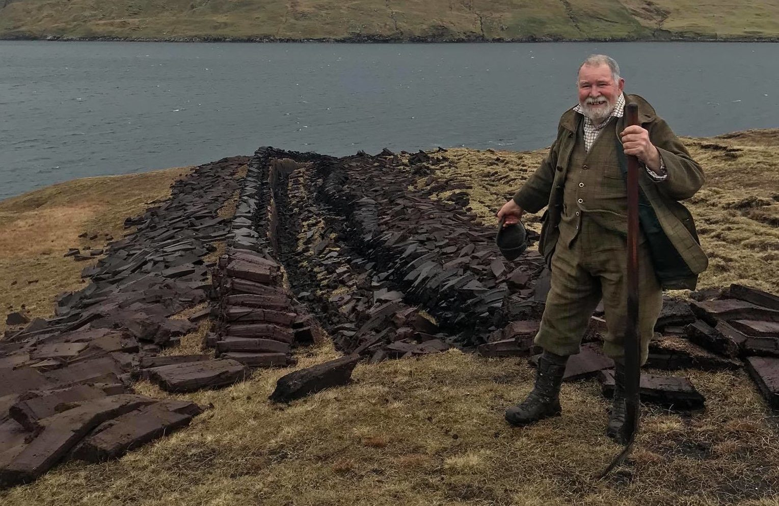 Bruce Wilcock perpetuates the tradition of cutting peat in Shetland.