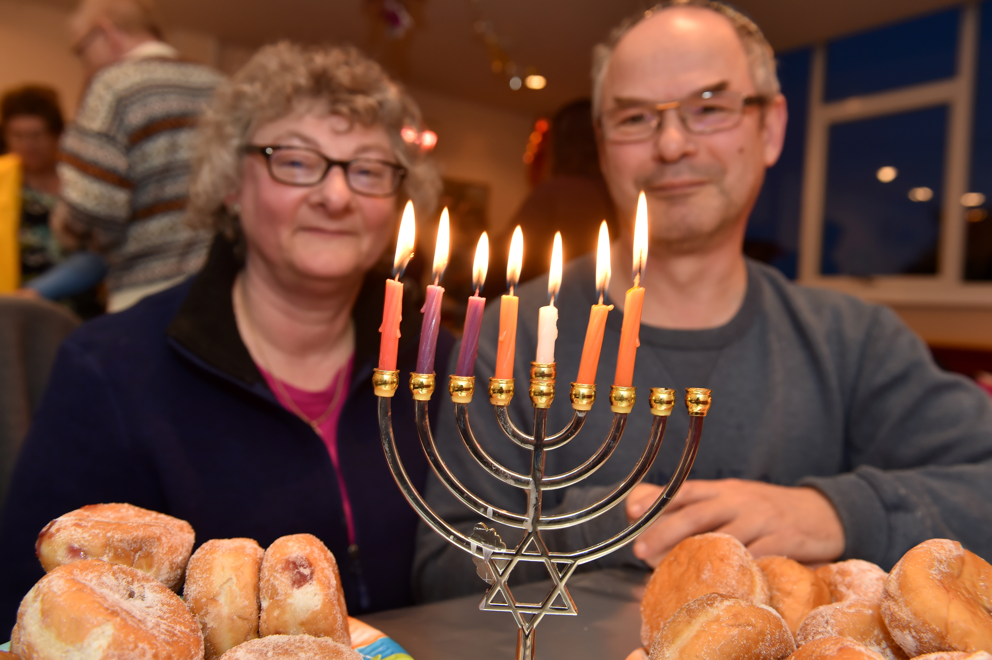 The Jewish community in Aberdeen celebrated Hanukkah  in Summerhill Church this year because their synagogue had been flooded.  Picture of Debby and Mark Taylor (head of Aberdeen Synagogue) with the Menorah.  Picture by KENNY ELRICK