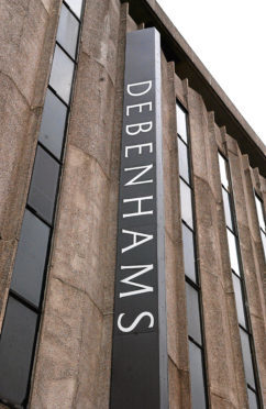 """File photo dated 16/01/07 of a Debenhams store in London. PRESS ASSOCIATION Photo. Issue date: Thursday October 22, 2009. The department store chain today hailed the success of its """"Designers at Debenhams"""" range in helping to deliver a 14% rise in annual profits. See PA story CITY Debenhams. Photo credit should read: Stephen JB Kelly/PA Wire"""
