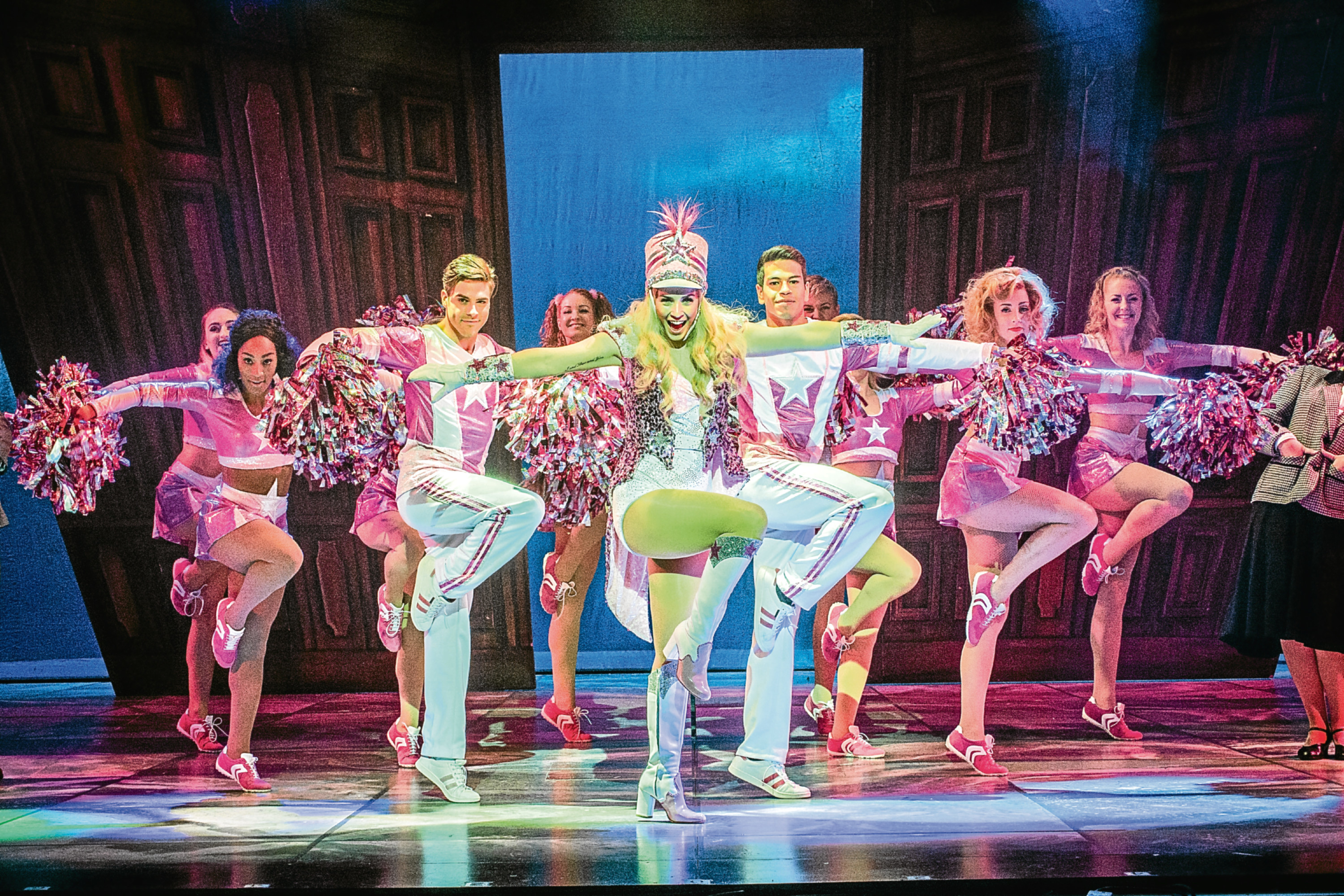 Lucie Jones as Elle Woods, centre, strutting her stuff with the dancers on stage