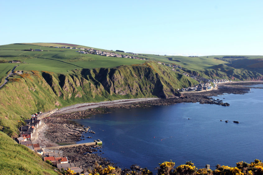 Picture taken with Crovie in foreground and showing the walk round the Sneuk to Gardenstown