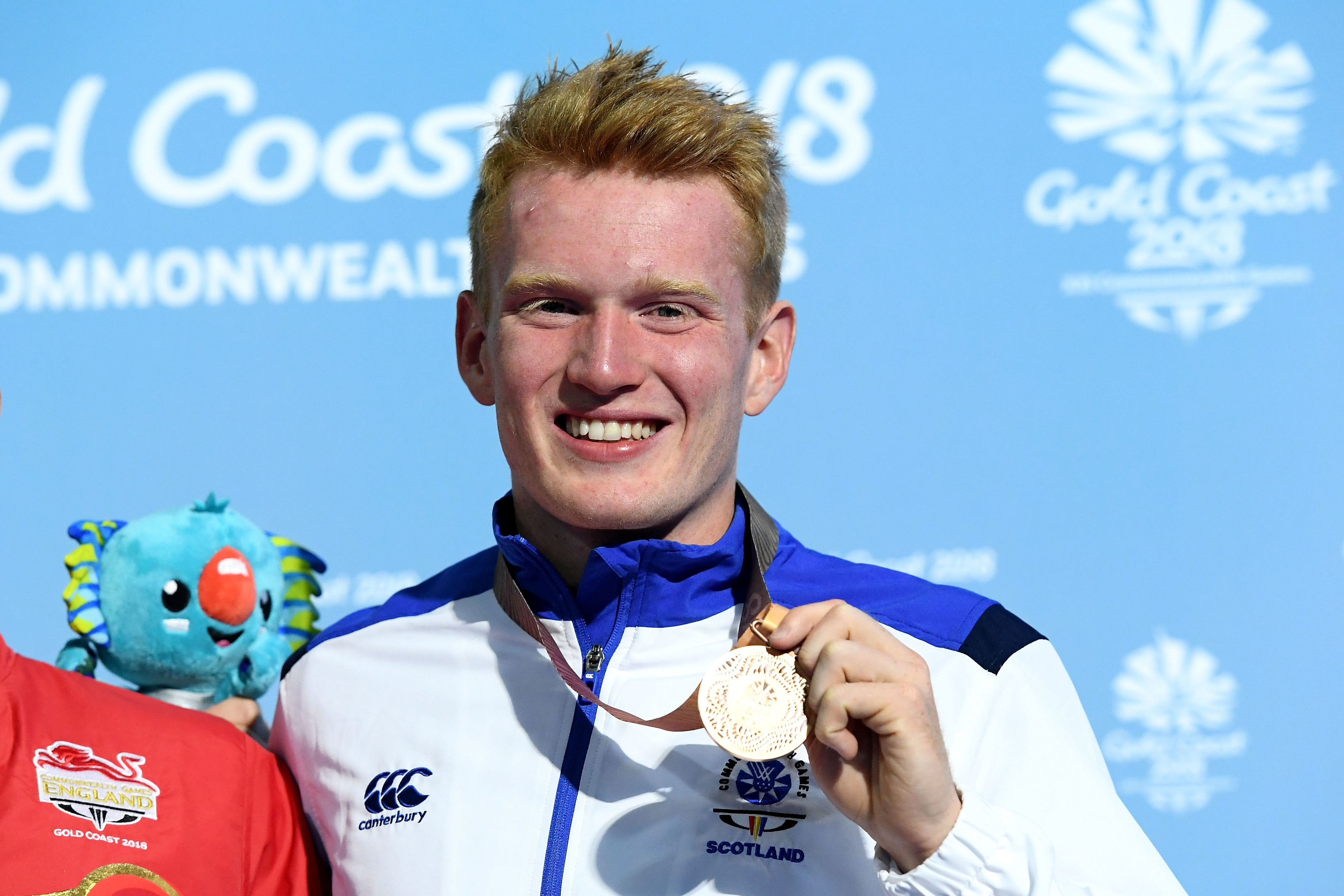 Bronze medalist James Heatly of Scotland poses during the medal ceremony for the Men's 1m Springboard Diving Final