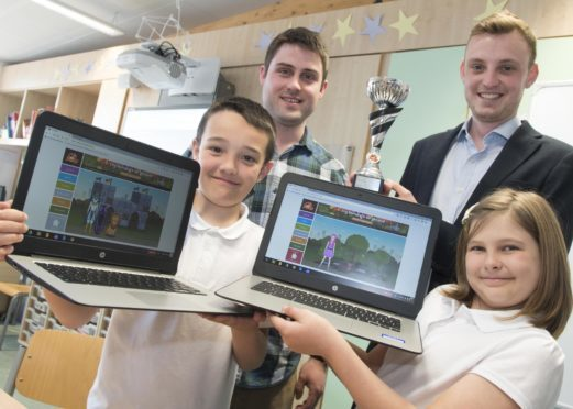L-R Lucas Main and Aimmie Mills-both 9YO pr5 answered the most questions correctly in their class- pictured with their teacher Mark Clayson and Charles Mathias, Sumdog UK manager