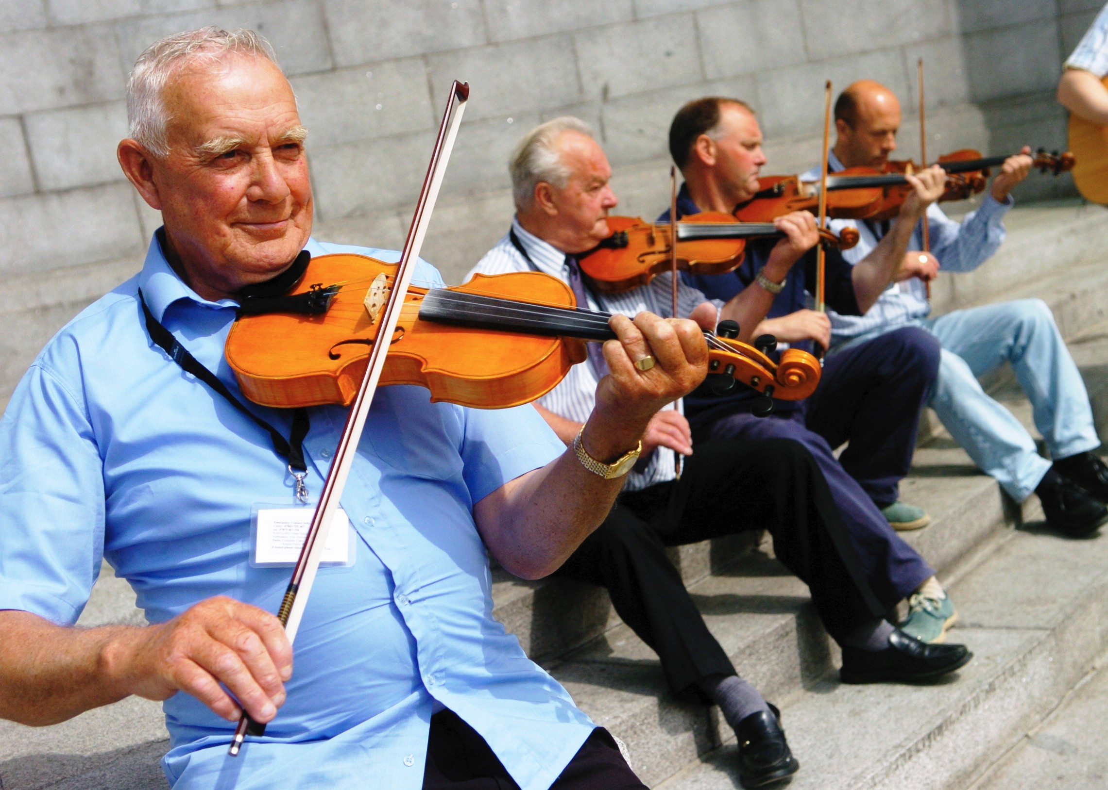 Angus Henry, John Henderson, Christopher Thomason and Danny Jamieson performing outside the Cowdray Hall for the 2006 North Atlantic Fiddle Convention. Picture by Peter Anderson