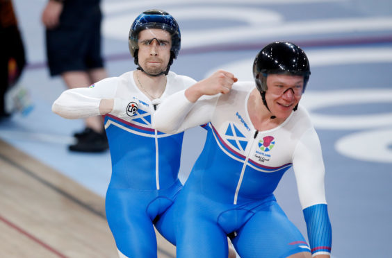 Scotland's Neil Fachie (left) and pilot Matt Rotherham celebrate winning gold in the Men's B&VI 1000m time trial.