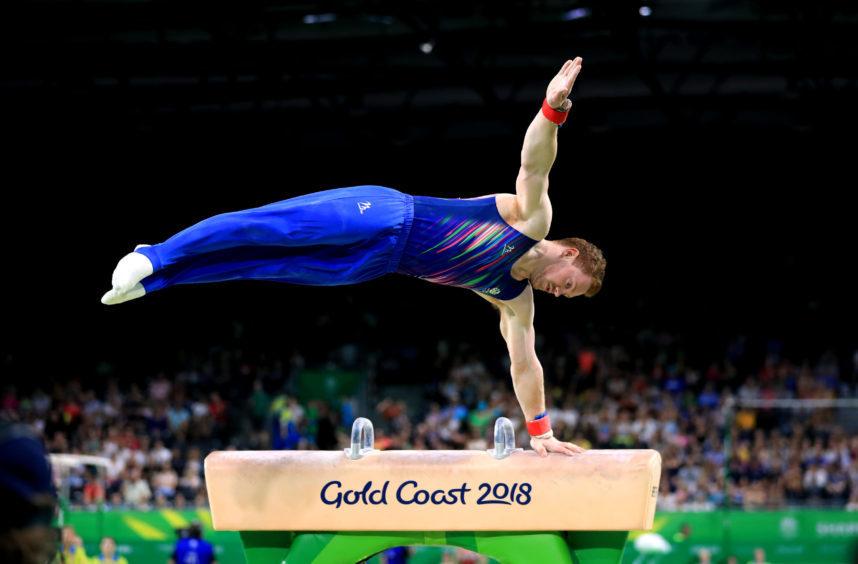 Scotland's Daniel Purvis on the Pommel horse during the men's gymnastics team event final.