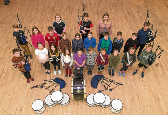 Forres Youth Pipe Band, who range in age from eight to 11, are keeping traditional music alive. Photograph by Jason Hedges