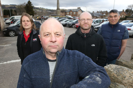 Local business owners in Dingwall are protesting against the proposed introduction of parking charges at the town's Cromarty Car Park. Left-to-right: Alicen Lawrie (correct), David Campbell, Graeme Dolier, Saeed Shirvani.