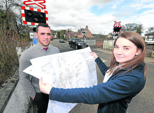 Alice Wilson of Network Rail, Project Manager for the installation of barriers over the Dingwall Number 1 and Dingwall Middle level crossings which are due to begin shortly. Also in the photograph is Brian MacLeod, Area Level Crossings Manager with Network Rail.