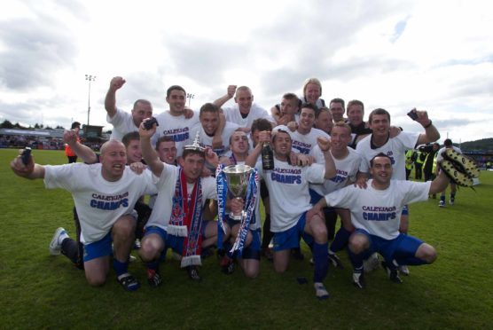The Inverness Caley Thistle players celebrate being crowned Bell's First Division champions in 2004.