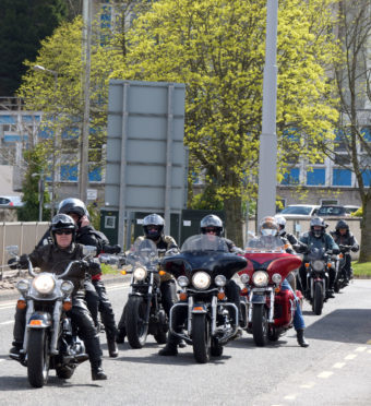 Harley owners parade through Fort William in the town's 'Rumble Under the Ben' Harley Davidson rally.