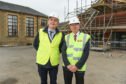 Marc Macrae, planning chairman, and Graham Jarvis, head of lifelong learning, outside the new construction area at Milne's Primary School.